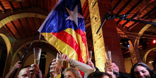 People react to results in Catalonia's regional elections at a gathering of the Catalan National Assembly...