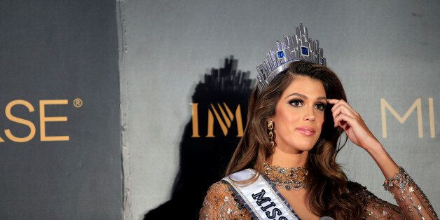 Newly-crowned Miss Universe Iris Mittenaere from France gestures during a news conference inside a Mall...