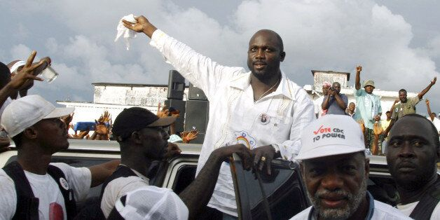 Liberian presidential candidate and former world footballer of the year George Weah (C) arrives for an...