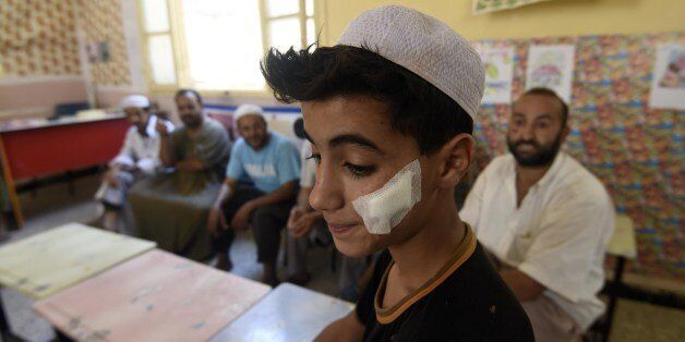 An Algerian youth from the Berber community stands at school where families took shelter on July 10,...