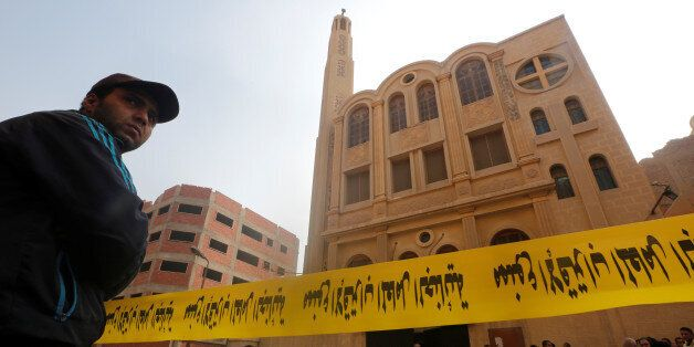Police tape cordon is seen at the site of attack on a church in the Helwan district south of Cairo, Egypt...