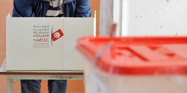 A Tunisian man casts his vote on December 21, 2014 at a polling station Ariana near Tunis. The second...