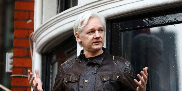 WikiLeaks founder Julian Assange speaks on the balcony of the Ecuadorian Embassy in London, Britain,...