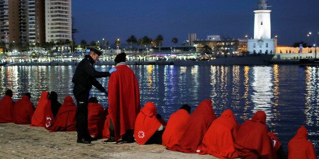 A migrant, part of a group intercepted aboard a dinghy off the coast in the Mediterranean Sea, talks...