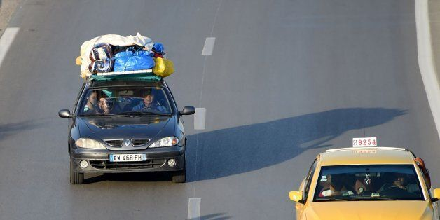 Tunisians return from the beach on the motorway from the port city of La Goulette to Tunis on the outskirts...