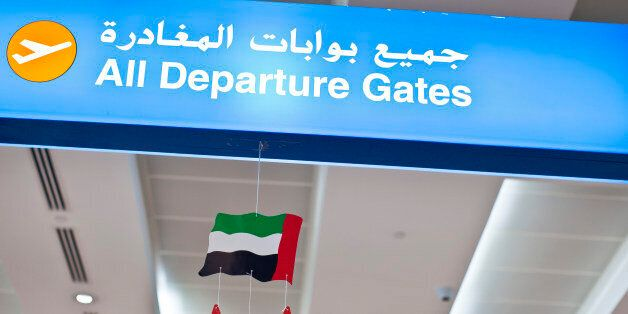 DUBAI, AIRPORT, United Arab Emirates - DECEMBER 25: A sign for the departure gates with the national...