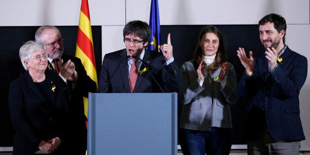 Carles Puigdemont, the dismissed President of Catalonia, arrives to speak after watching the results...