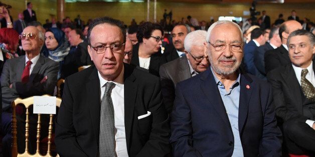 Hafedh Caid Essebsi (L), leader of Nidaa Tounes party, and Tunisian Islamist Ennahdha party leader Rached...