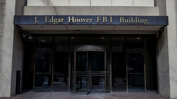 The J. Edgar Hoover FBI Building on Monday, March 4, 2019, in Washington. The FBI is stepping up its efforts to root out foreign corruption with a new squad of agents in Florida. The Miami-based squad begins later this month as part of the bureau's international corruption unit. (AP Photo/Alex Brandon)