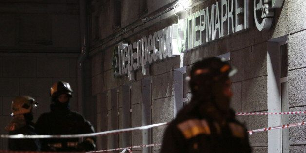Russian Emergency Ministry members gather outside a supermarket after an explosion in St Petersburg,...