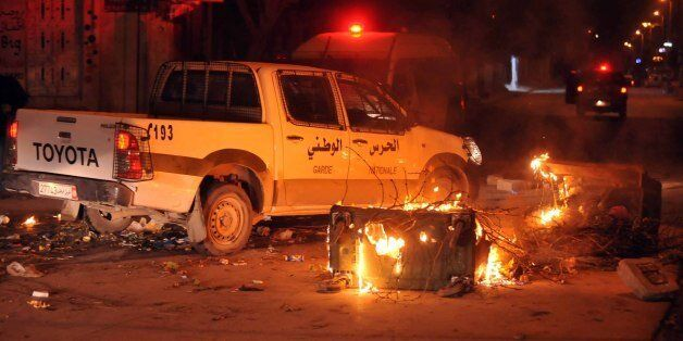 Tunisian police track down rioters in Ettadhamen on the outskirts of Tunis late on January 8, 2018 after...