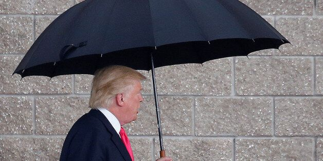 Republican presidential nominee Donald Trump arrives in the rain for a campaign rally in Tampa, Florida,...