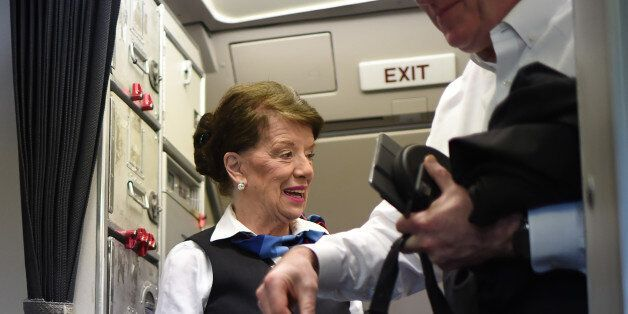 American Airlines longest serving flight attendant, Bette Nash (L), 81 years old, greets passengers disembarking...