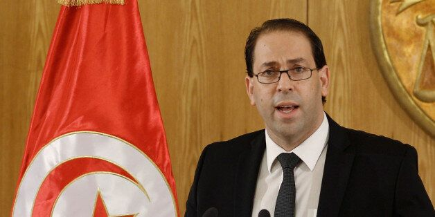 Tunisia's Prime Minister-designate Youssef Chahed speaks during a news conference after his meeting with...