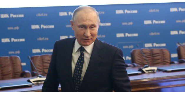 MOSCOW, RUSSIA - DECEMBER, 27 (RUSSIA OUT) Russian President Vladimir Putin attends a registration as...
