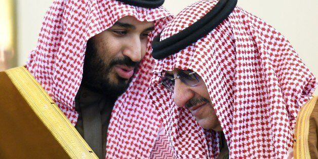 Saudi Defence Minister Mohamed bin Salman (L) talks with Crown Prince and Interior Minister Mohammed...