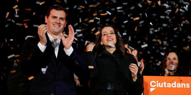Catalan Ciudadanos leader Ines Arrimadas (C) smiles next to Ciudadanos national leader Albert Rivera...