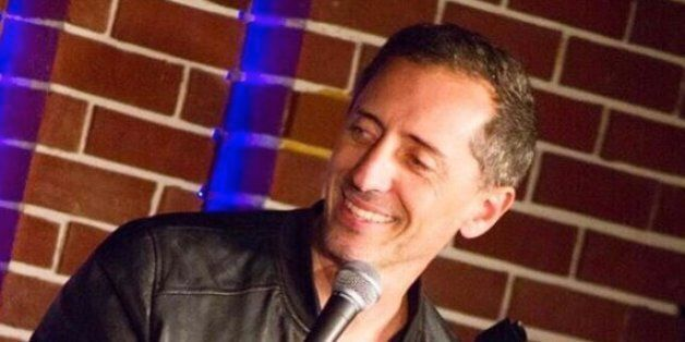 Actor Gad Elmaleh poses for cinema fans as he arrives for the screening of the
