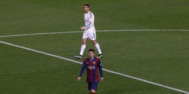 Barcelona's Argentinian forward Lionel Messi (DOWN) and Real Madrid's Portuguese forward Cristiano Ronaldo...