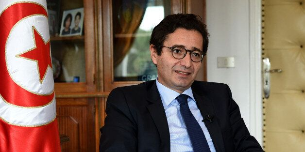 Tunisia's investment and international cooperation minister Fadhel Abdelkefi speaks during an interview...