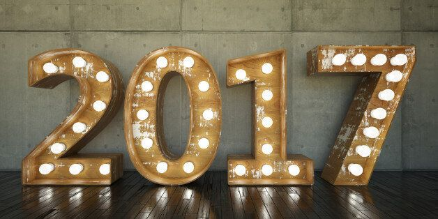 Lightbulb sign with 2017 against concrete