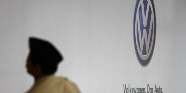 A police constable stands guard at Volkswagen AG's India plant in Chakan, India, on Saturday, Dec. 12,...
