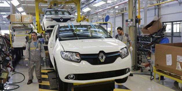 Employees work in the new Renault factory in Oran, west of Algiers November 10, 2014. French carmaker...