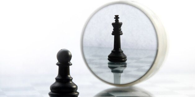 pawn pieces on the chessboard, the reflection in the mirror king, often in life things and people are...