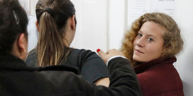 Palestinian Ahed Tamimi (R), 16, a well-known campaigner against Israel's occupation, appears at a military...