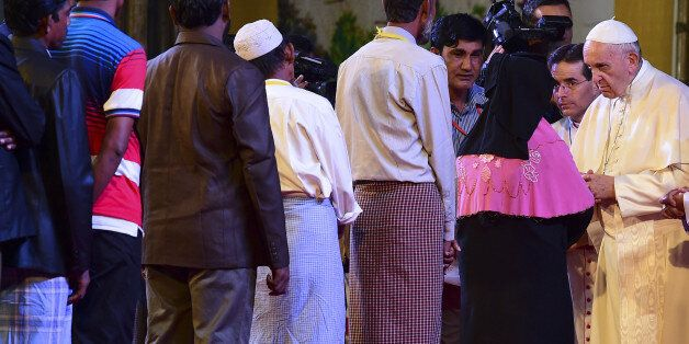 Pope Francis speaks with a Rohingya refugees during an interreligious meeting in Dhaka on December 1,...