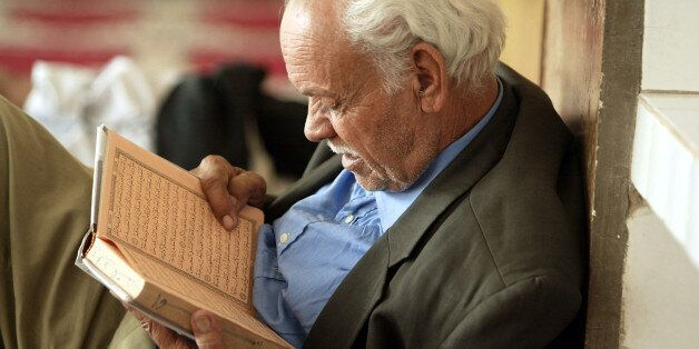 An elderly man reads the Koran in the Kawtar Mosque in Blida during the holy month of Ramadan, in Algiers...