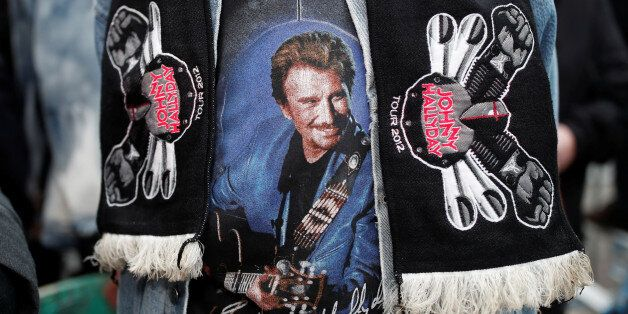 A fan of late French singer and actor Johnny Hallyday talks to journalists in Marnes-la-Coquette near...