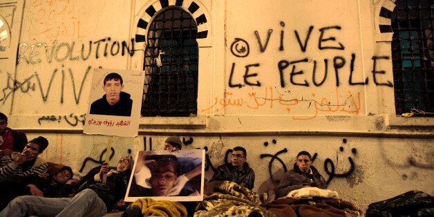 Protesters from Tunisia's marginalised rural heartlands prepare to spend their second night outside the...