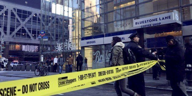NEW YORK, USA - DECEMBER 11 : A New York Police Department (NYPD) officer allows a girl through 'Do Not...