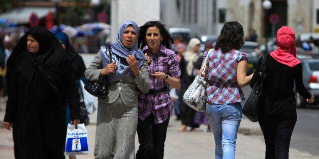 Women in different styles of dress walk in Algiers May 10, 2010. A French proposal to ban full face veils...