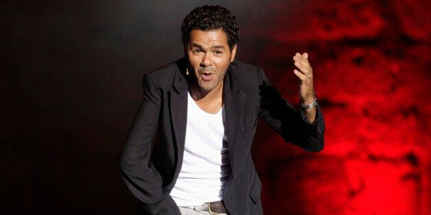 French comedian Jamel Debbouze performs during the Carthage International Festival at the Carthage Roman...