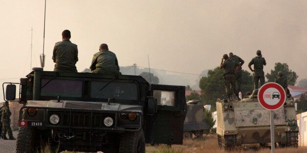 Tunisian soldiers gather near the border with Algeria around Mount Chaambi, western Tunisia August 2,...