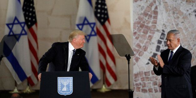 U.S. President Donald Trump (L), talks on a podium near Israeli Prime Minister Benjamin Netanyahu at...
