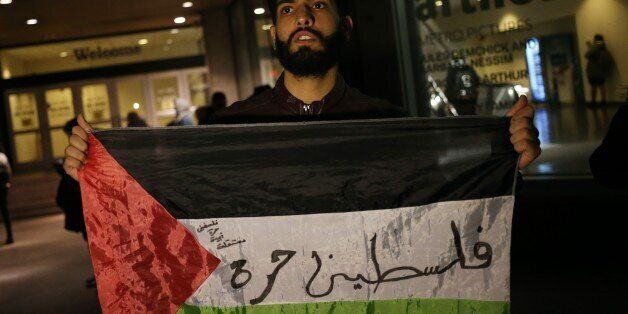 NEW YORK, USA - DECEMBER 6 : A student holds a Palestinian flag during a protest against the US President...