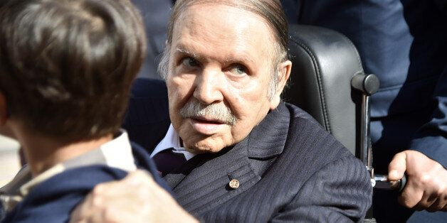 Algerian President Abdelaziz Bouteflika is seen while voting at a polling station in Algiers on November...