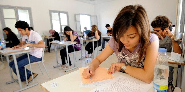 Tunisian students take the baccalaureat (high school graduation exam) exam on June 6, 2012 in Tunis....