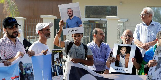 Relatives of the leaders of Morocco's Hirak protest movement shout slogan outside the court in Casablanca,...