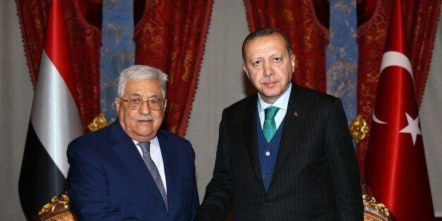 ISTANBUL, TURKEY - DECEMBER 12: Turkey's President Recep Tayyip Erdogan (R) meets Palestinian President...