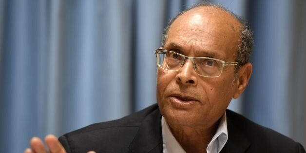 Former interim Tunisian president Moncef Marzouki speaks during a joint press conference with a Yemeni...