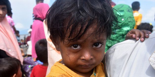 Hundreds of Rohingya people crossing Bangladesh's border as they flee from Buchidong at Myanmar after...
