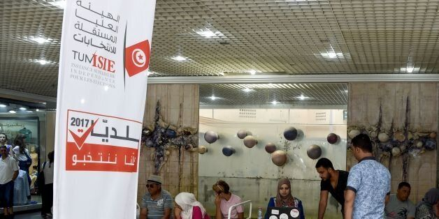 A picture taken on August 4, 2017 shows employees of the Tunisian ISIE elections body sitting at an outreach...