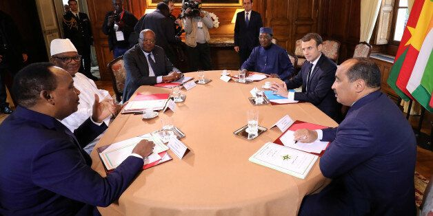 French President Emmanuel Macron (2ndR) hosts a meeting with Burkina Faso's President Roch Marc Christian...