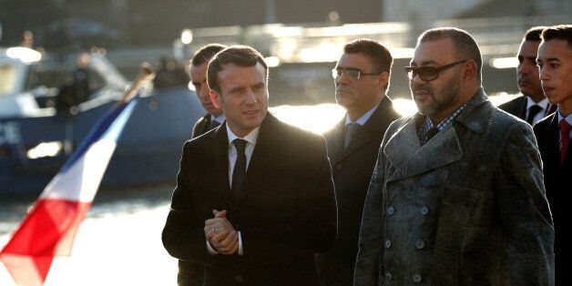 French President Emmanuel Macron (L) and Morocco's King Mohammed VI (R) board the 'Mirage' boat on the...