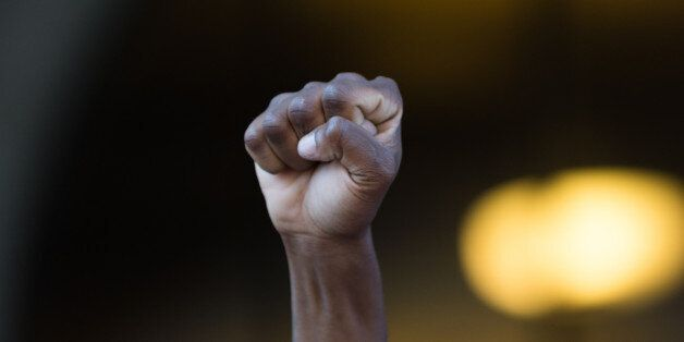 Los Angeles, USA - July 12, 2016 - Black lives matter protestor put their fists in the air as a sign...