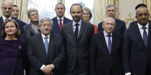 French Prime Minister Edouard Philippe (C) and his Algerian counterpart Ahmed Ouyahia (2ndL) pose for...